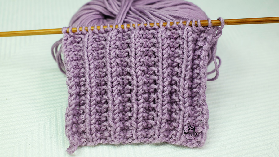 Easy two-row repeat knitting stitch pattern: Identical on both sides, and it doesn't curl. So Woolly.