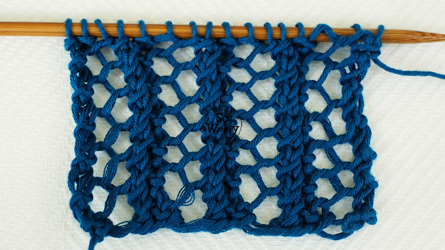 Reversible lace knitting stitch (three steps and one-row repeat pattern). So Woolly.