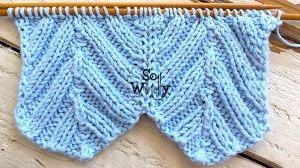 Symmetry in the Chevron stitch knitting pattern